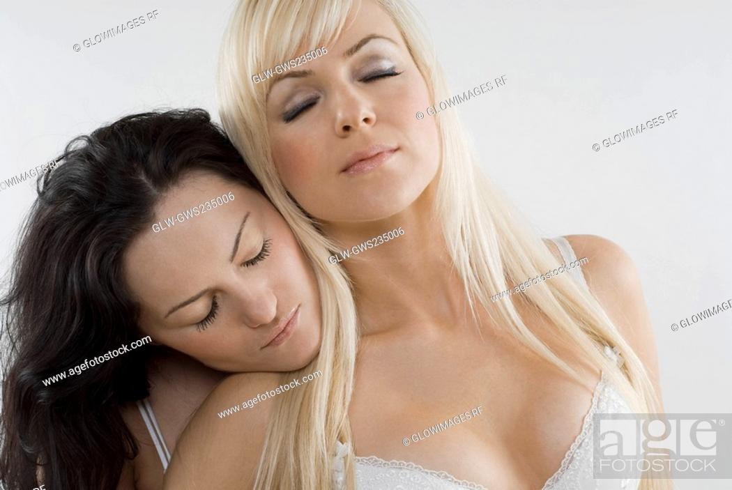 Stock Photo: Close-up of a female homosexual couple with their eyes closed.