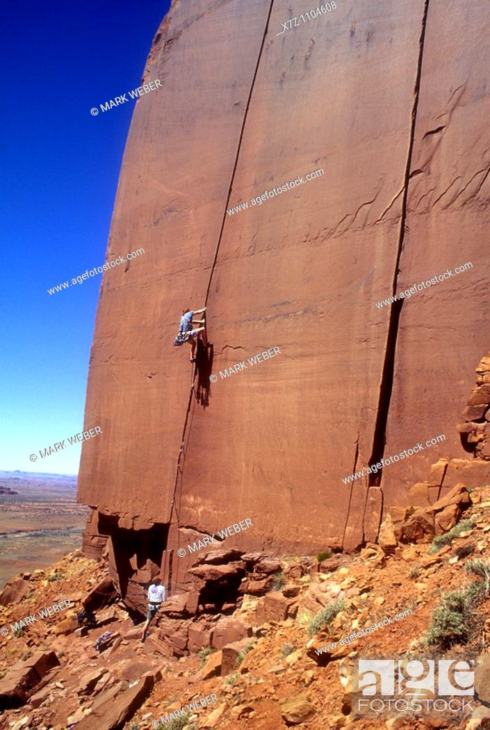 Stock Photo: Man, rock climbing The Wiggins 1 route on the Cliffs Of Insanity in Indian Creek Canyon, Utah.