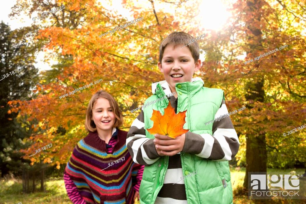 Stock Photo: Boy and girl holding mushroom.