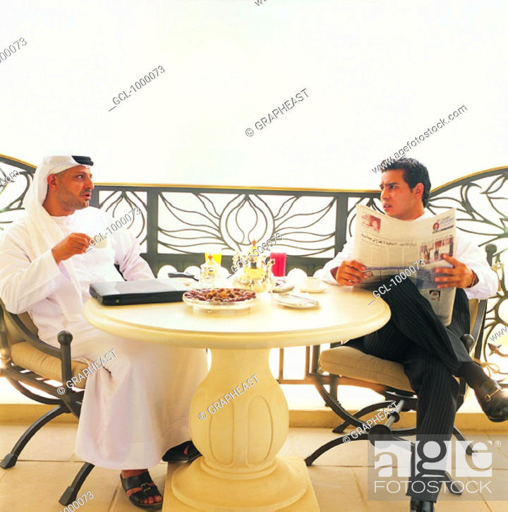 Stock Photo: Arab businesspeople at lunchbreak.