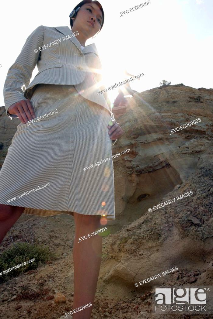 Stock Photo: View of a woman standing on a cliff.