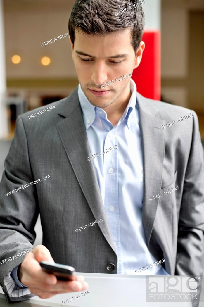 Stock Photo: Close-up of a businessman text messaging.