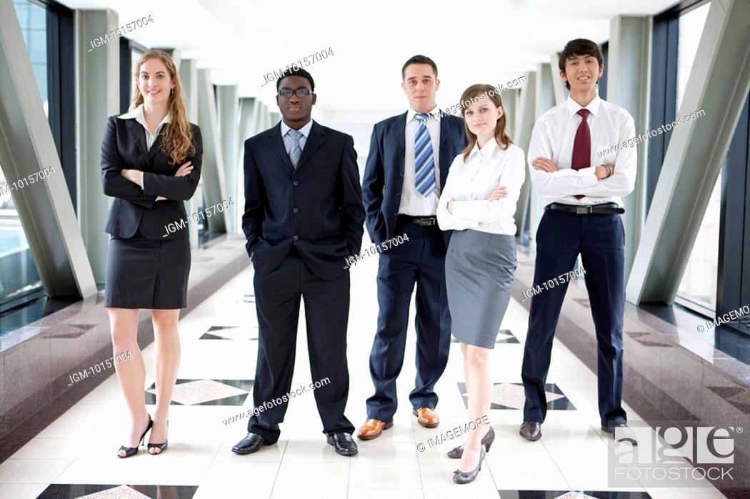 Stock Photo: Business people standing together and looking at the camera with confidence.