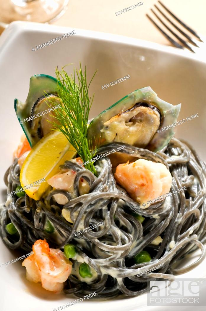 Stock Photo: fresh seafood black squid ink coulored spaghetti pasta tipycal italian food.