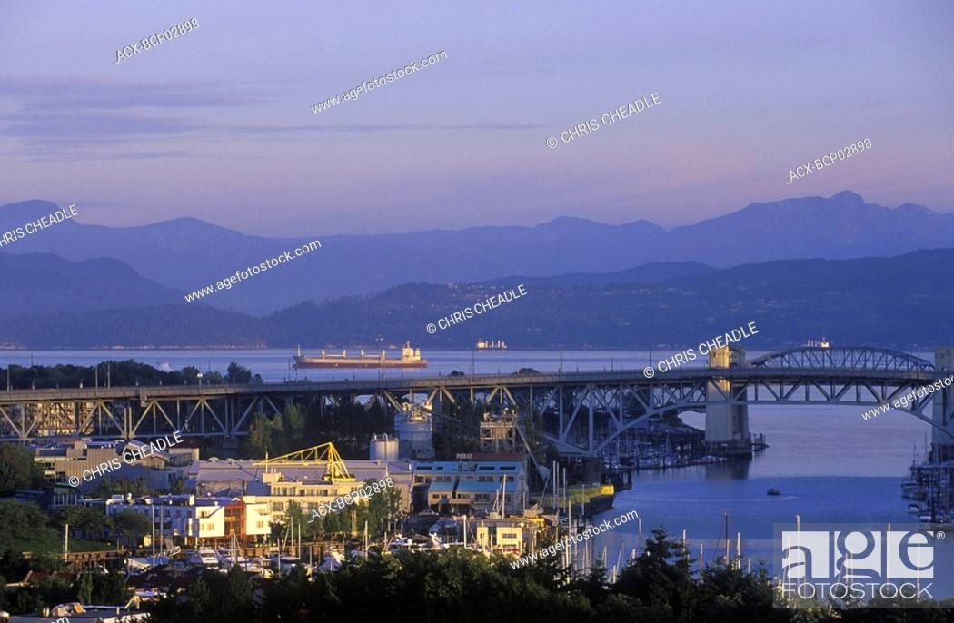 Stock Photo: View to west across Granville Island to Burrard Bridge and freighters in Burrard Inlet, Vancouver, British Columbia, Canada.