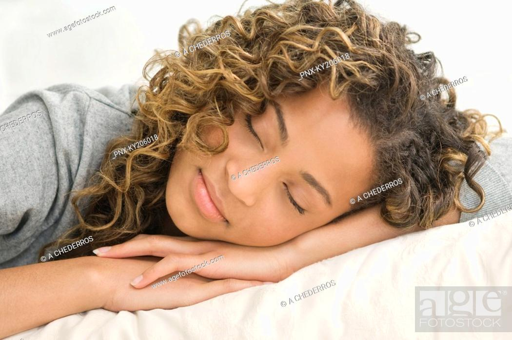 Stock Photo: Close-up of a girl sleeping on the bed.