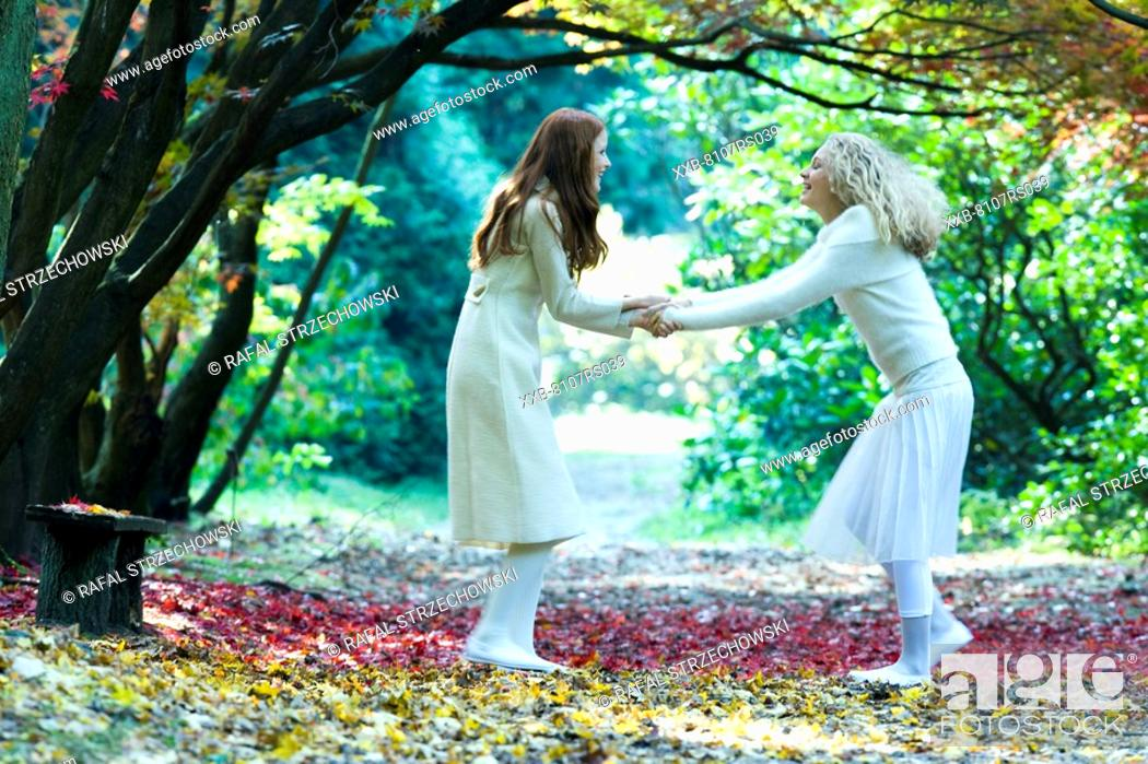 Stock Photo: Young woman dancing in park.
