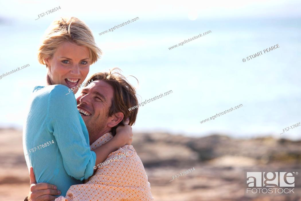 Stock Photo: Young couple on the beach.