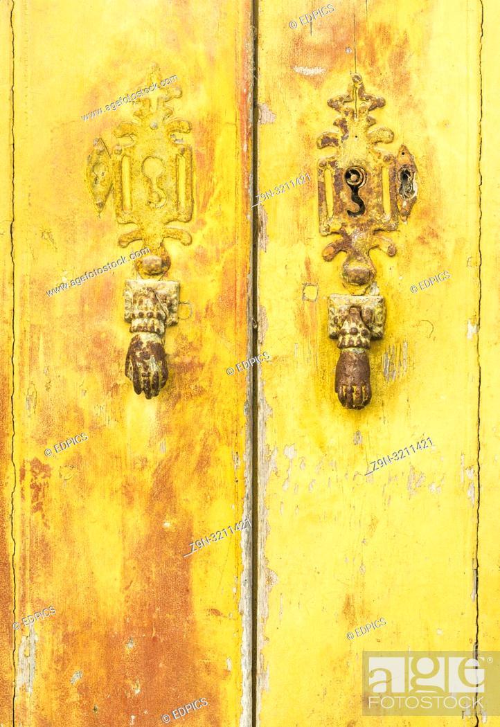 Imagen: historic doorknockers in the form of hands, lagos, algarve, portugal.