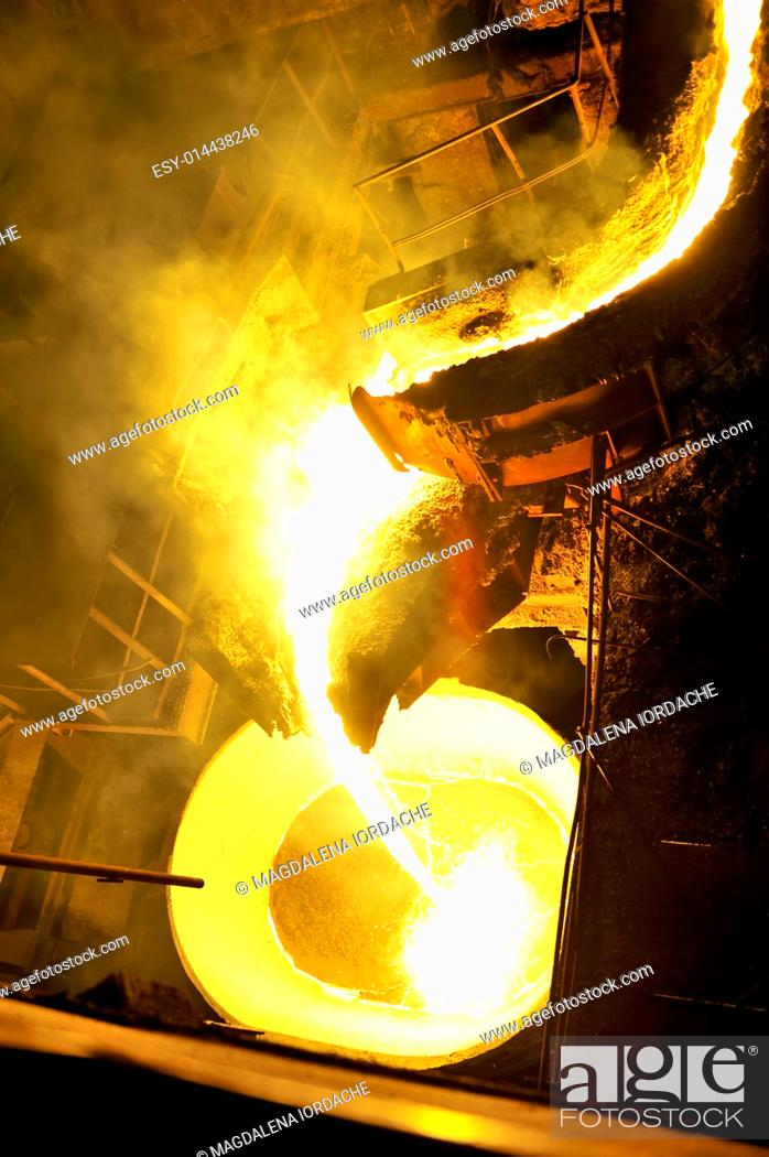 Stock Photo: Molten hot steel pouring.
