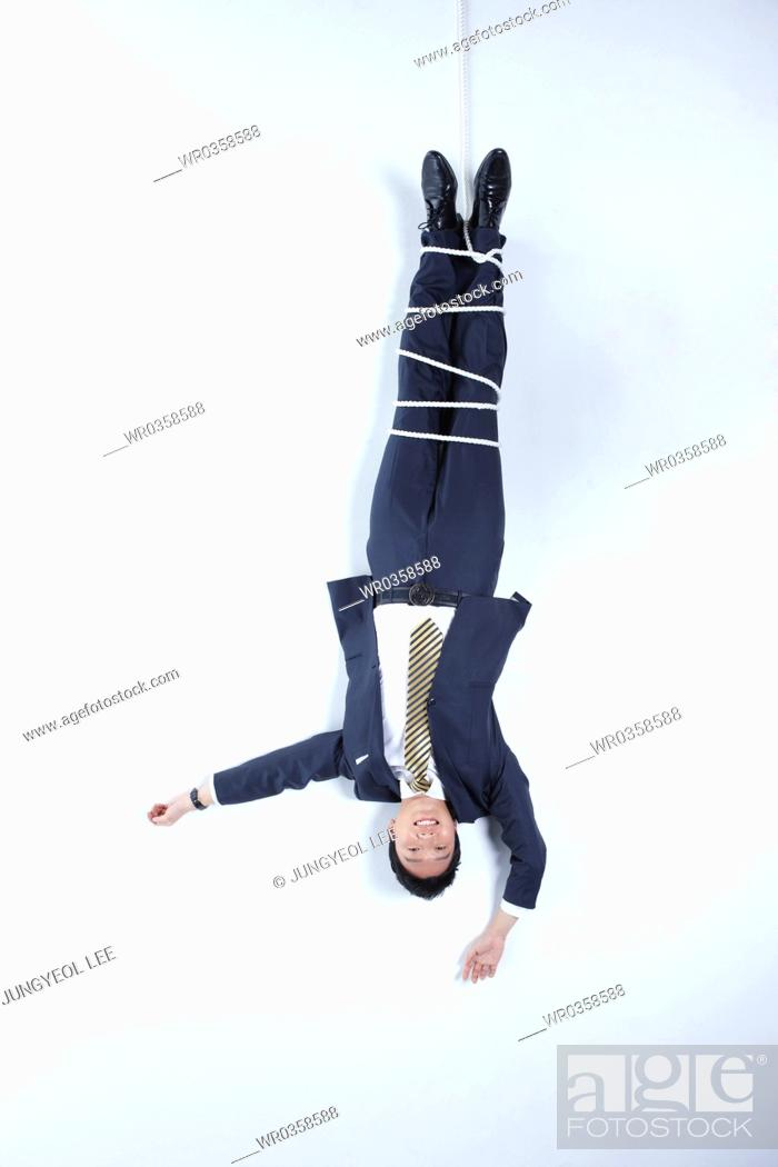Stock Photo: businessman dangling from the above.
