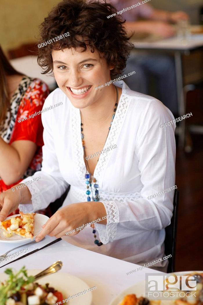 Stock Photo: Teenage girl eating pizza.