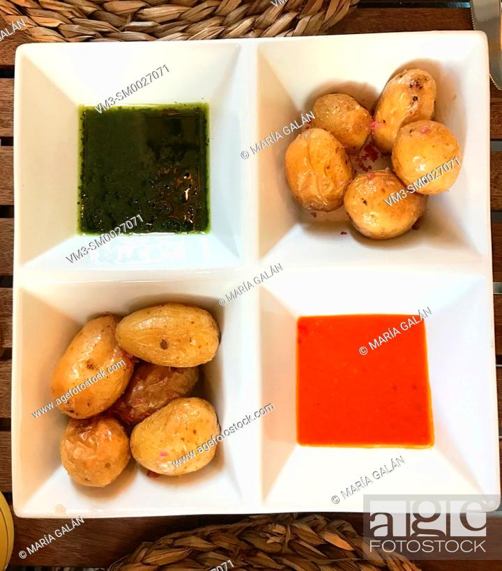 Stock Photo: Papas arrugadas with two mojo sauces. Canary Islands, Spain.