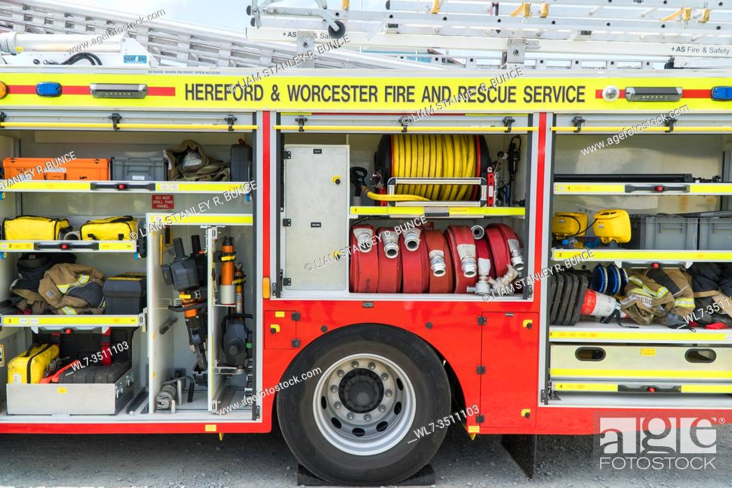 Stock Photo: Hereford and Worcester fire brigade, Fire engine storeage compartments filled with appropriate apparatus for emergencies, Herefordshire UK. July 2019.