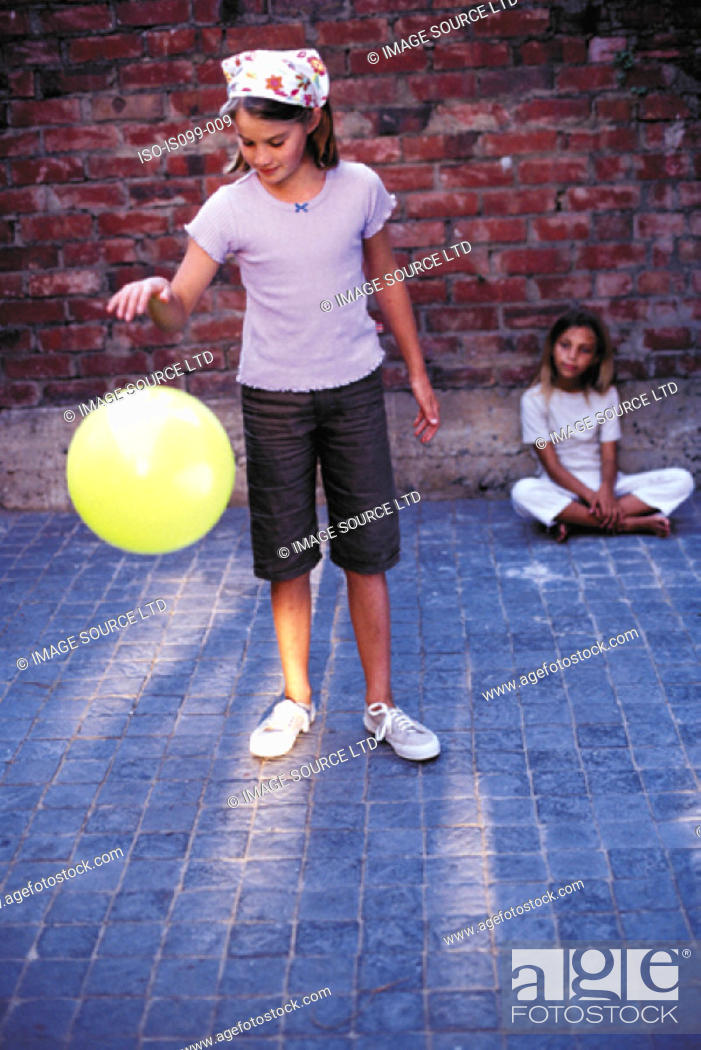 Stock Photo: Girls playing with a ball.