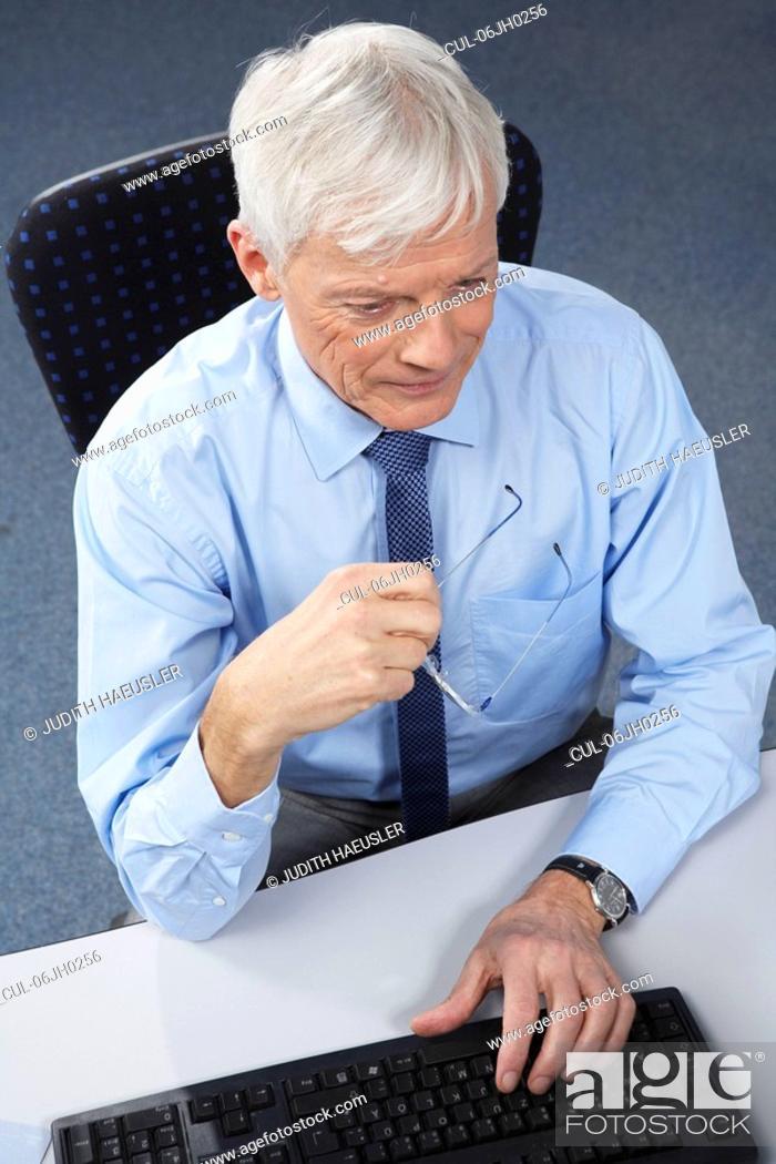 Stock Photo: Mature businessman at desk.