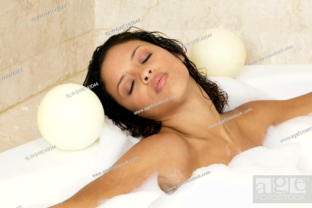 Stock Photo: Close-up of a teenage girl in a bathtub.