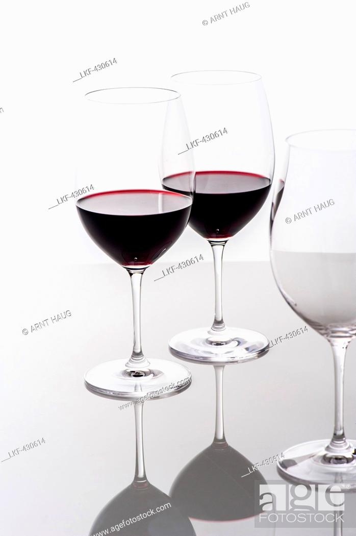 Stock Photo: Two glasses of red wine and an empty glass, Hamburg, Northern Germany, Germany.
