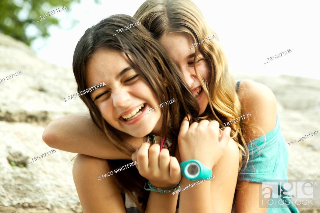 Stock Photo: Teenage friends hugging. Valencia, Spain.
