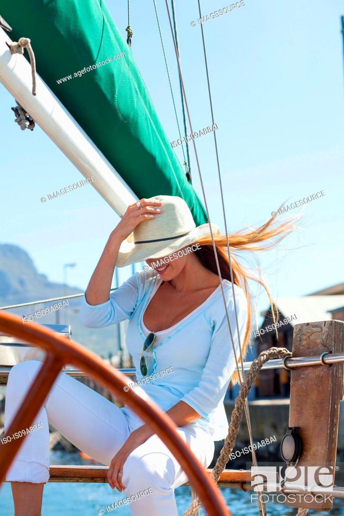 Stock Photo: Woman on yacht wearing sunhat.