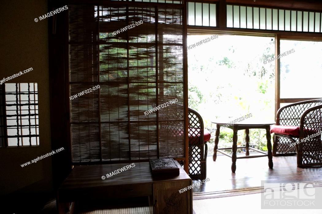 Stock Photo: View of seating arrangement in a porch.