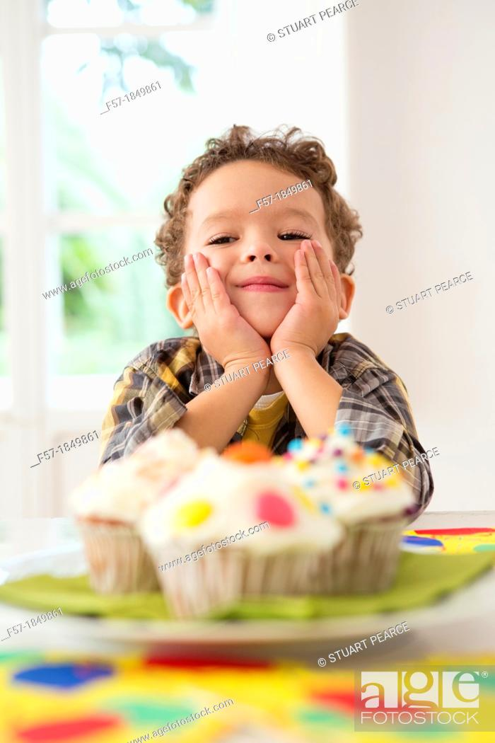 Stock Photo: Four year old boy waiting for a cupcake.