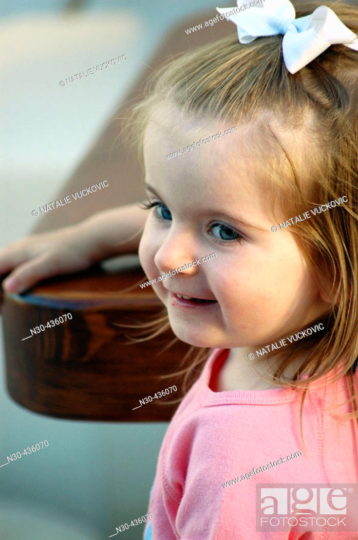 Stock Photo: Close up of Toddler Girl sitting at table.