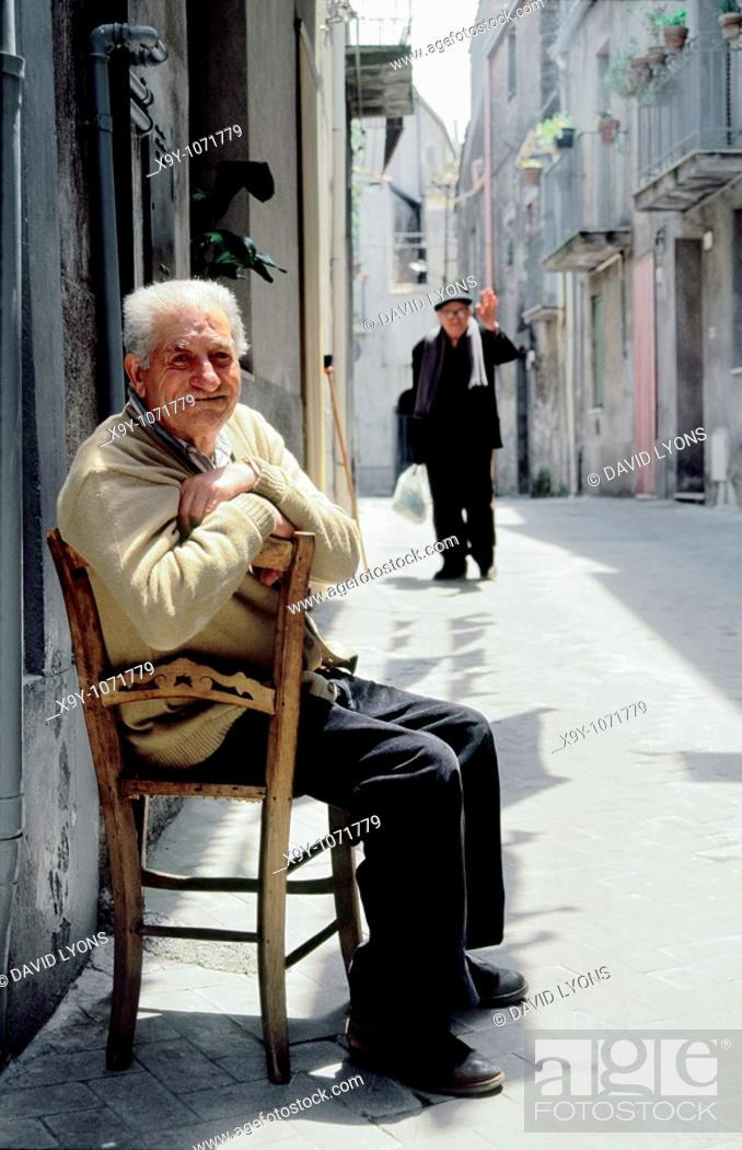 Stock Photo: Old elderly local people men in street of hill town of Randazzo, central Sicily, Italy.