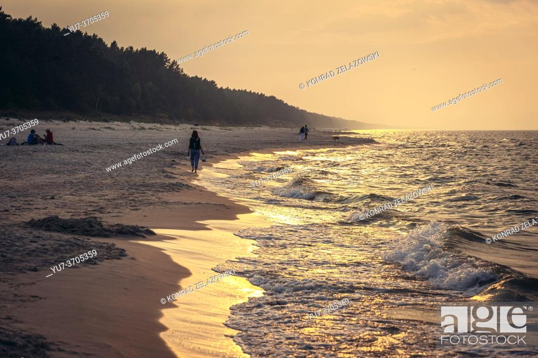 Photo de stock: Sunset over beach in Katy Rybackie village on Vistula Spit over Gdansk Bay in the Baltic Sea; Poland.