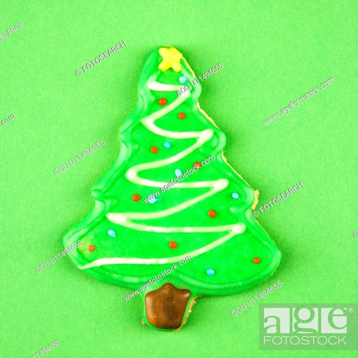 Stock Photo: Christmas tree sugar cookie with decorative icing.