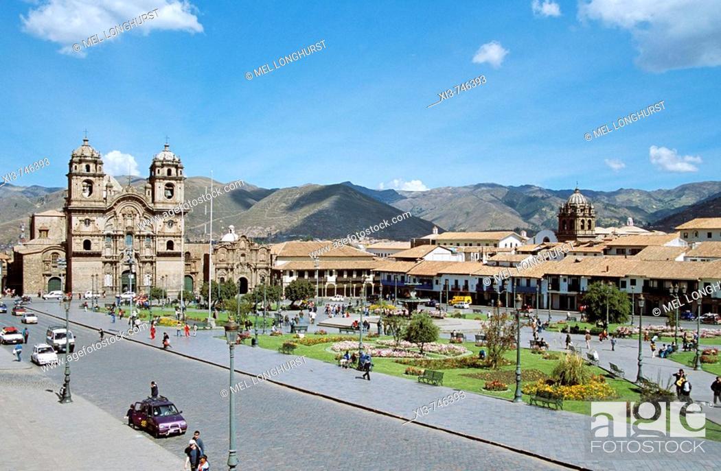 Stock Photo: Looking across Plaza de Armas to Iglesia La Compania de Jesus on the left, Cusco, Peru.