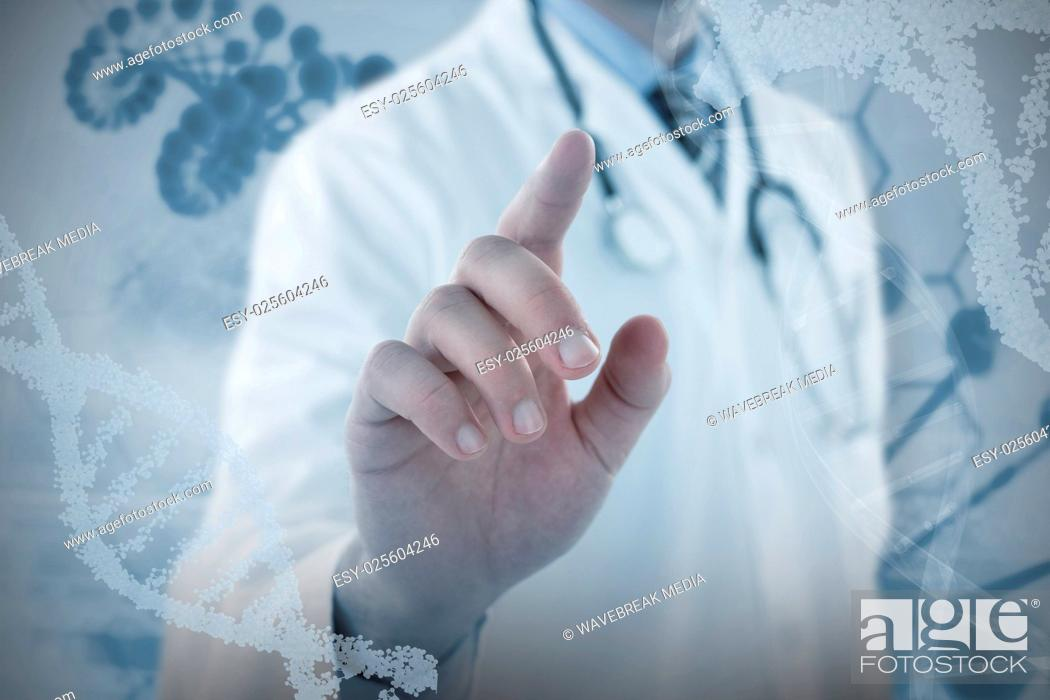 Stock Photo: Composite image of midsection of doctor touching digital screen.