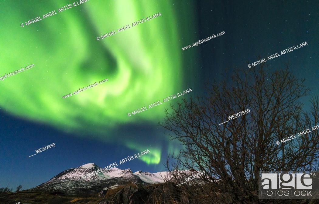 Stock Photo: Northern lights landscape in SENJA NORWAY without people. The bright dancing lights of the aurora are actually collisions between electrically charged particles.