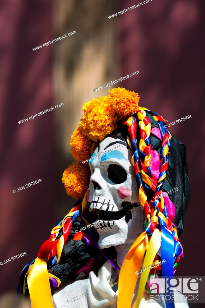 Stock Photo: A decorated skeleton figurine is seen at the altar of the dead (altar de muertos), a religious site honoring the deceased.
