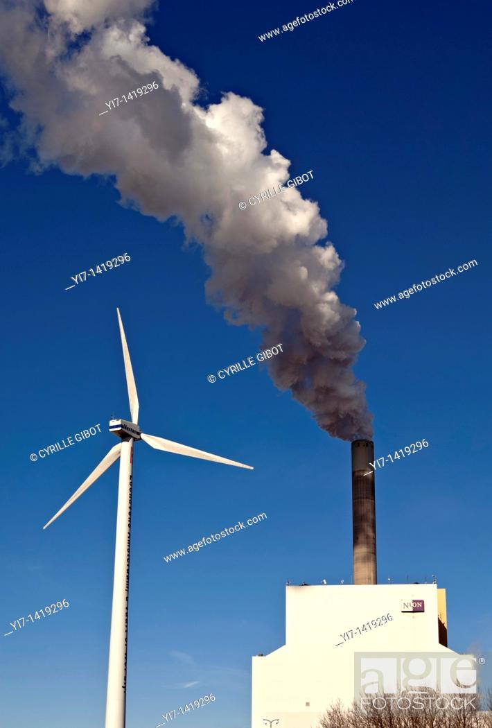 Stock Photo: Wind turbine and coal-fired power station next to each other, Amsterdam, the Netherlands.