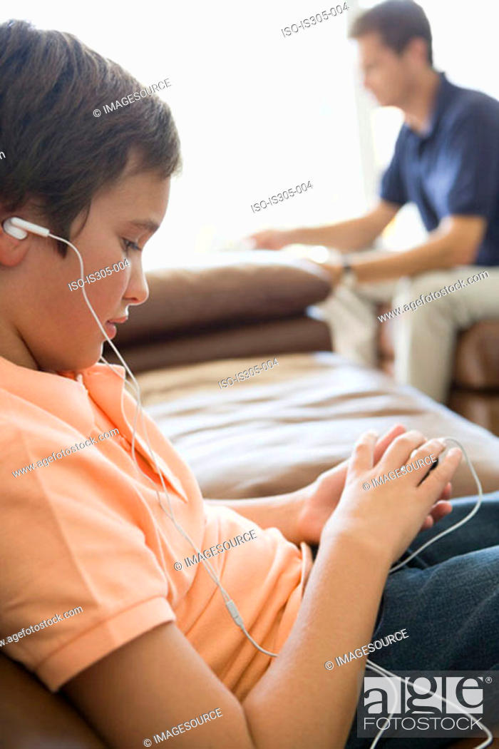 Stock Photo: Boy listening to MP3 player.