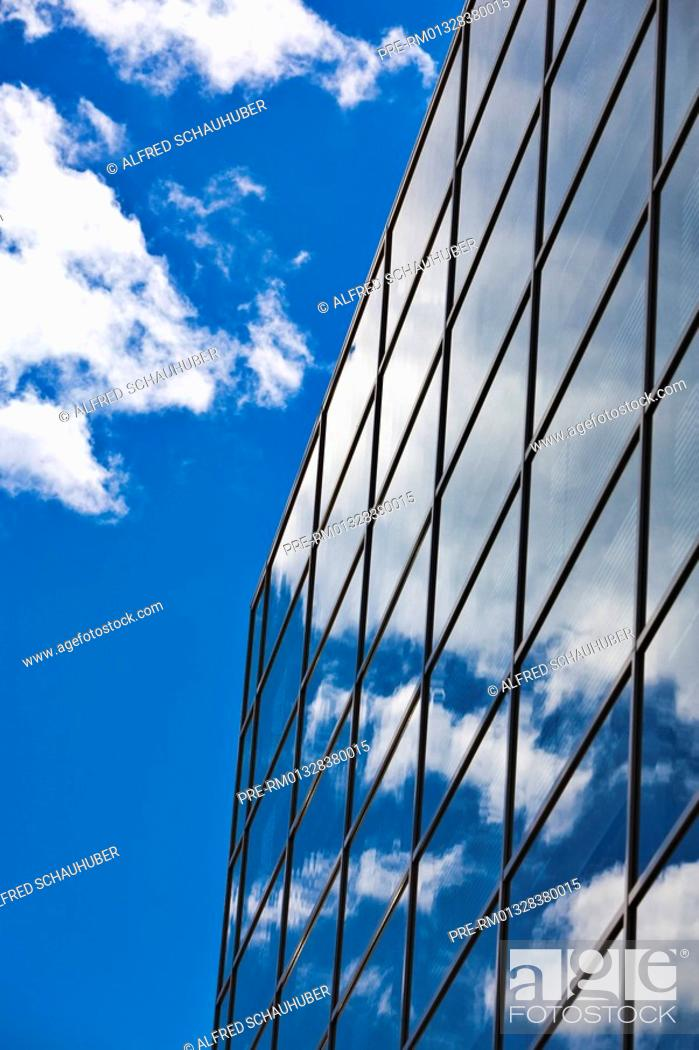 Stock Photo: Reflection of clouds in a glass-facade.