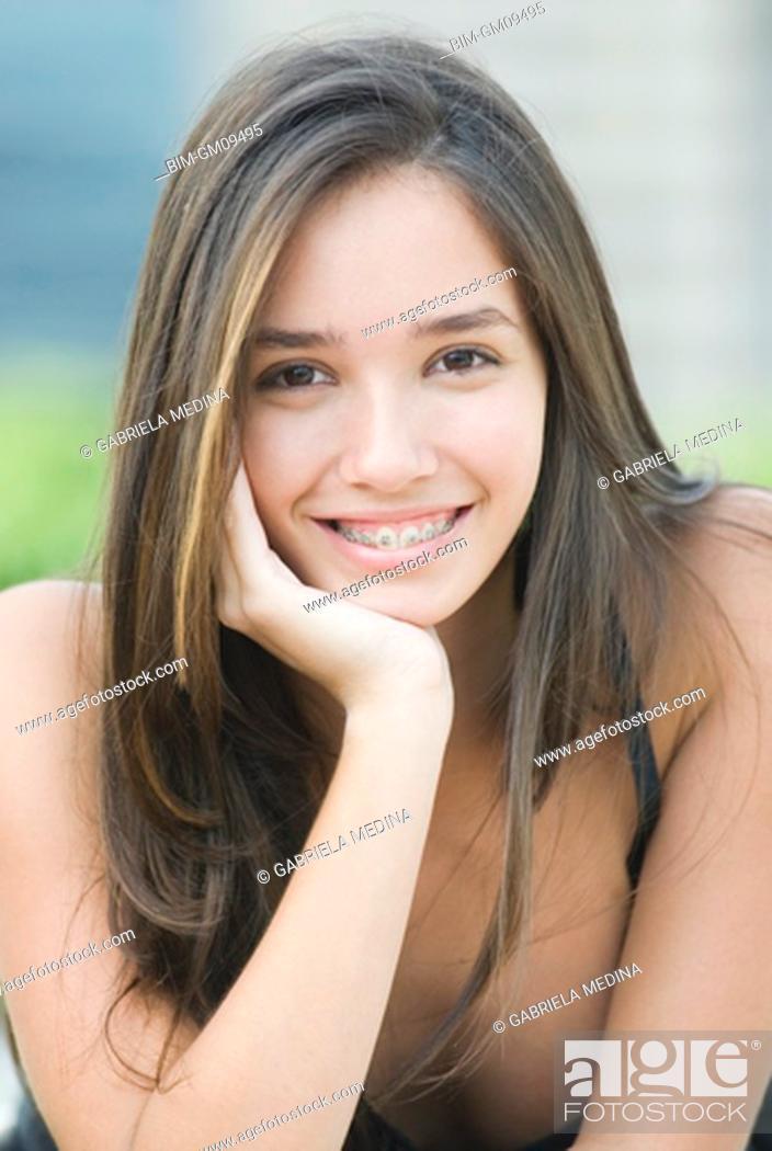 Stock Photo: Hispanic woman with orthodontic braces.
