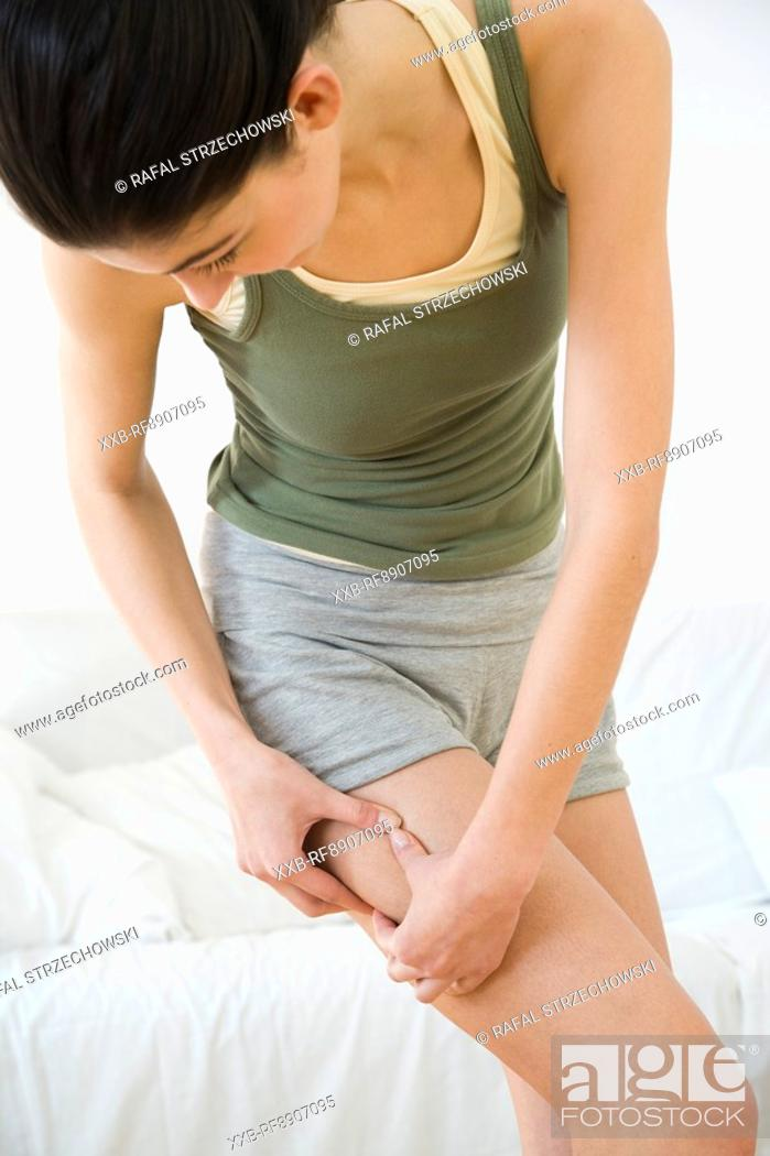 Stock Photo: young woman checking cellullite.