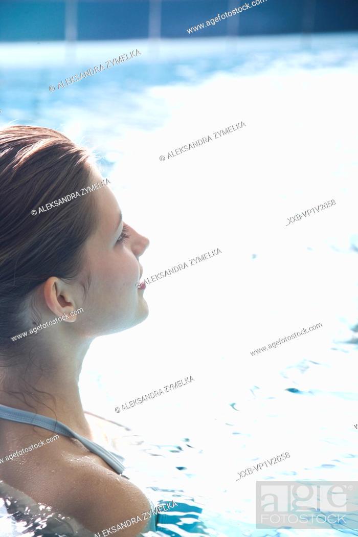 Stock Photo: woman relaxing in swimming pool.