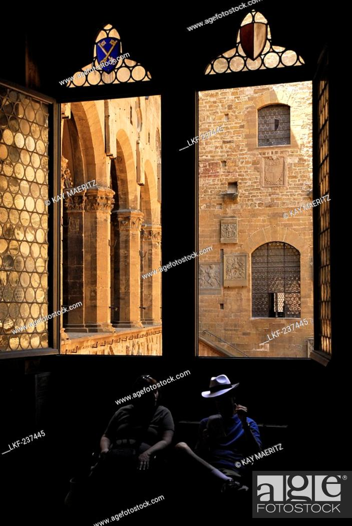 Stock Photo: Museo Nazionale del Bargello, window to the courtyard and two tourists sitting in the shadow, Florence, Tuscany, Italy, Europe.