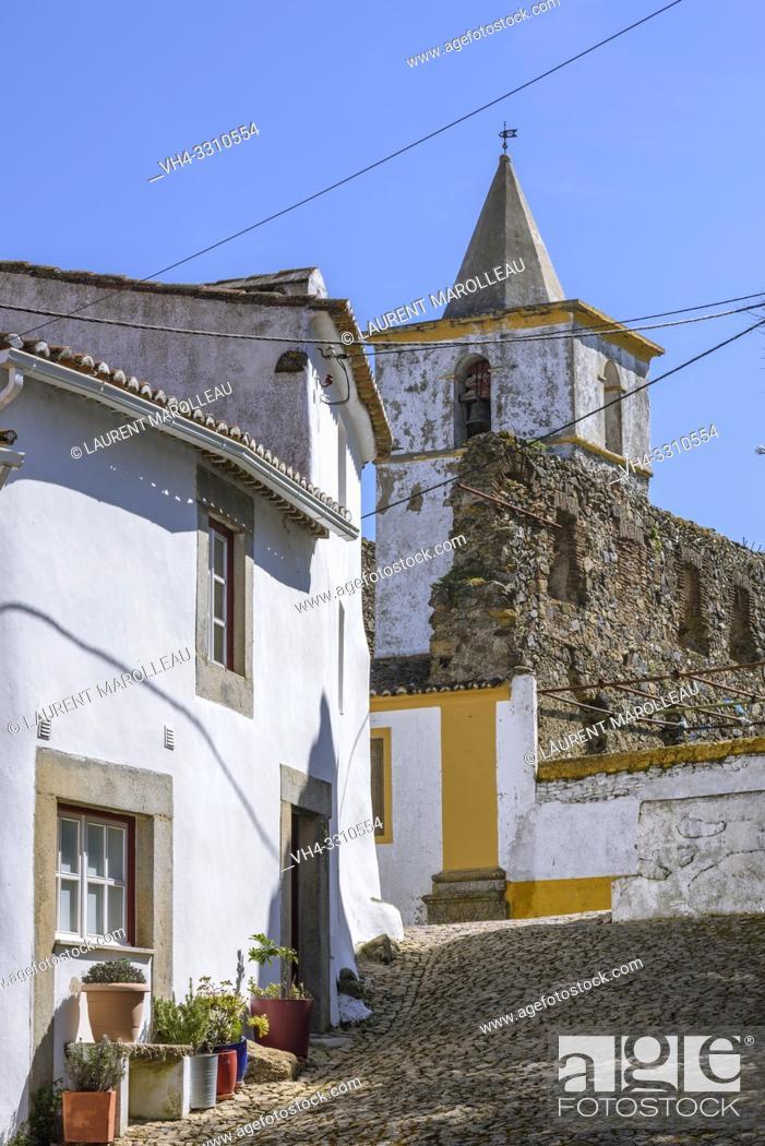 Stock Photo: Narrow street and Bell tower of Santa Catarina Convent in the Medieval quarter of Castle, Castelo de Vide village, Portalegre District, Alentejo Region.