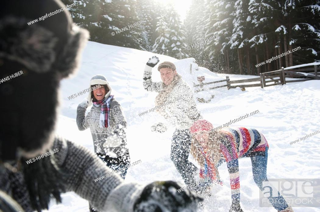 Stock Photo: Austria, Salzburg Country, Flachau, Young people snow fighting in snow.