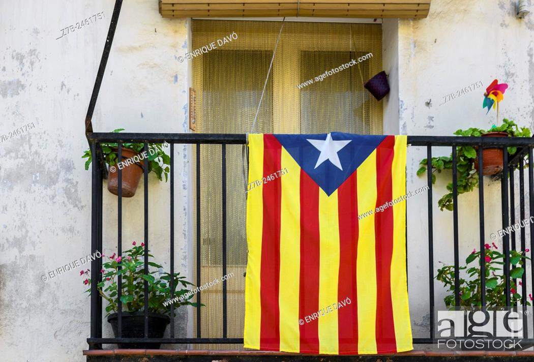 Stock Photo: View of some flower pots with Catalonia flag in Balaguer town, Lerida province, Spain.