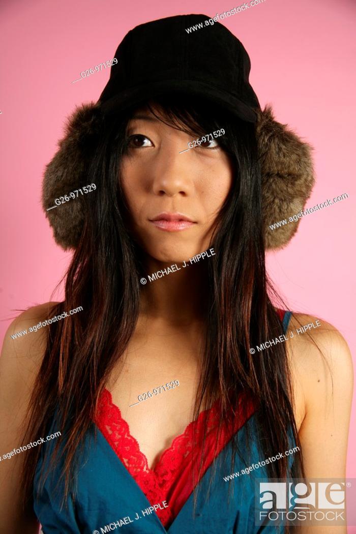 Stock Photo: Asian-American woman looking thoughtful.