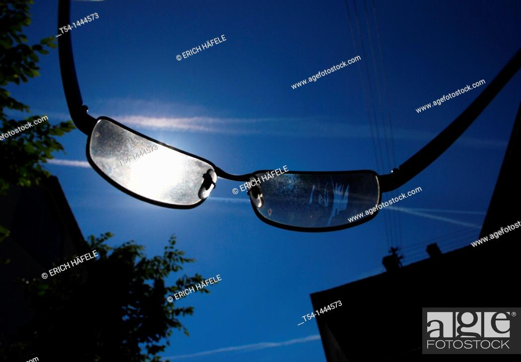 Stock Photo: Looking through a pair of sunglasses in the sun.