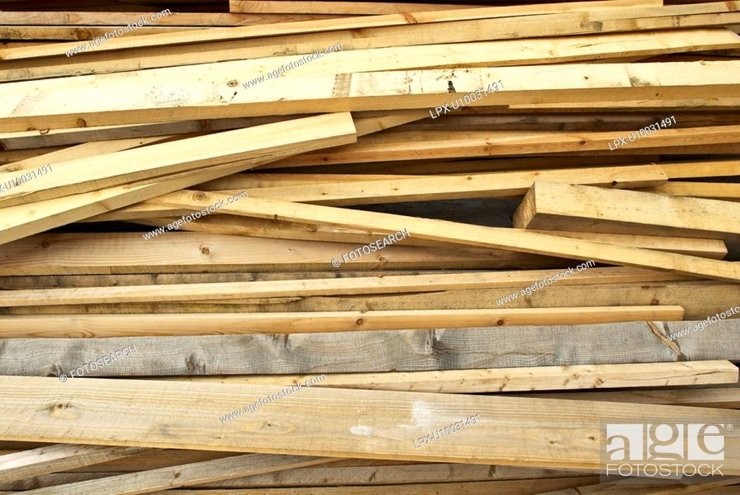 Stock Photo: Stacked wood in timber's merchant warehouse.