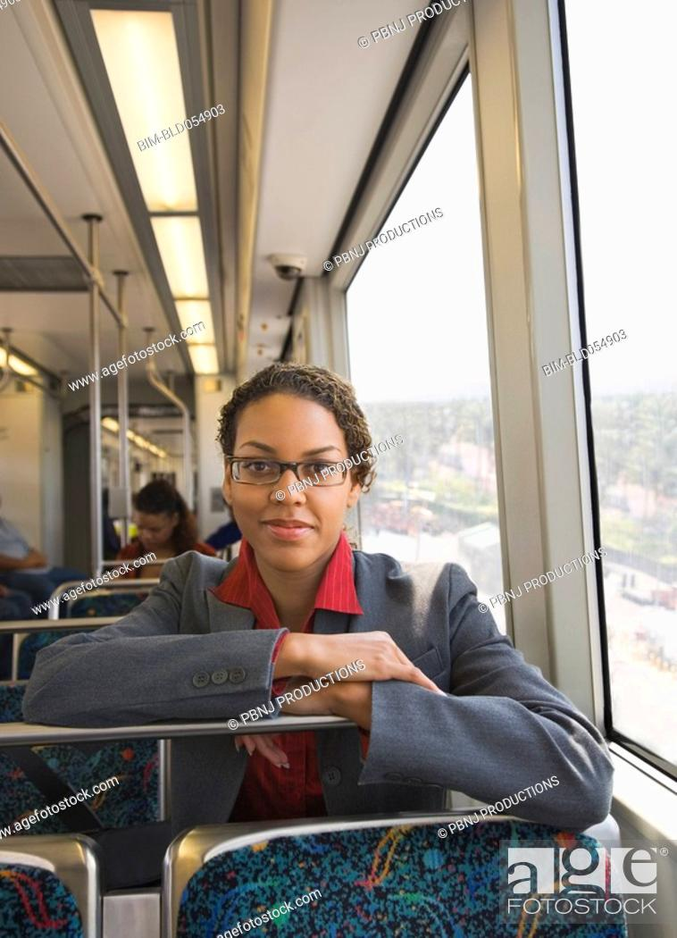 Stock Photo: African businesswoman riding on train.