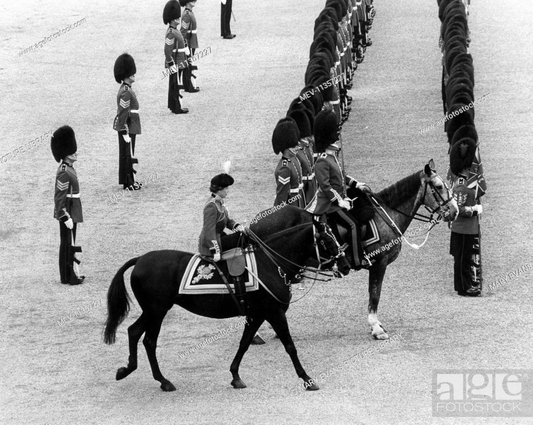 Stock Photo: Queen Elizabeth II riding at the Trooping the Colour ceremony for the last time in 1986 on her horse Burmese.