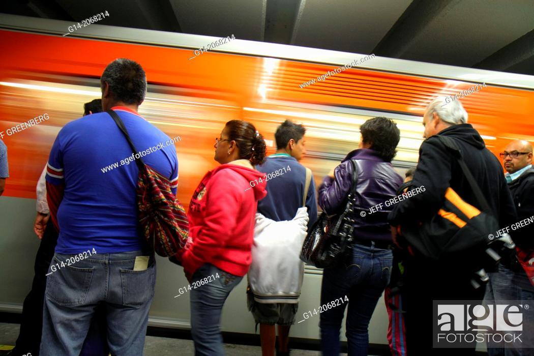 Stock Photo: Mexico, Mexico City, DF, D.F., Distrito Federal, Metro subway, STC, mass transit, public transportation, Hildago Station, Line 2, platform, Hispanic, man, woman.